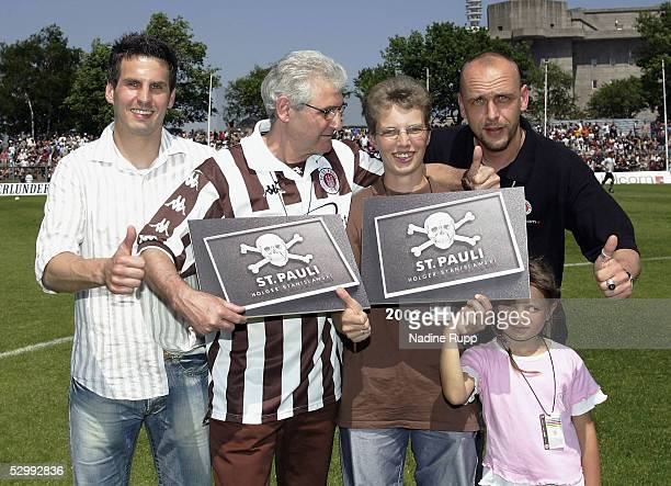 Thomas Meggle and Holger Stanislawski give longlive tickets for Pauli to Reinhard Schoeneberger and Nicole kook during the match of the Third...