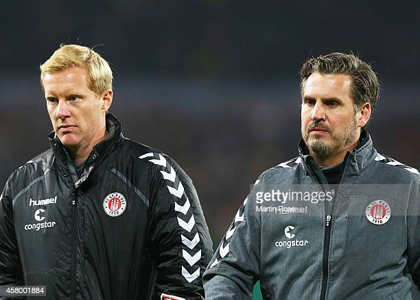 Thomas Meggle Head Coach and Timo Schultz of FC St Pauli during the DFB Cup match between St Pauli and Borussia Dortmund at Millerntor Stadium on...
