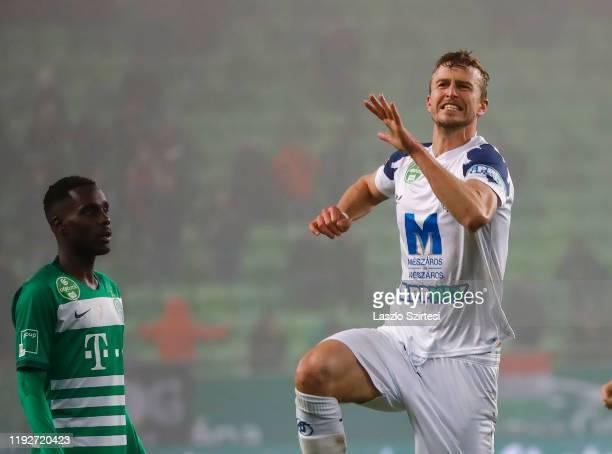 Thomas Meißner of Puskas Akademia FC celebrates his goal next to Tokmac Chol Nguen of Ferencvarosi TC during the Hungarian OTP Bank Liga match...