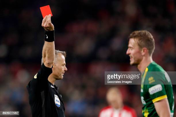 Thomas Meissner of ADO Den Haag receives a red card from Referee Bjorn Kuipers during the Dutch Eredivisie match between PSV v ADO Den Haag at the...