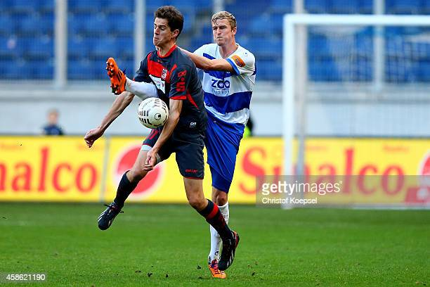Thomas Meissner of Duisburg challenges Christian Falk of Erfurt during the third League match between MSV Duisburg and RW Erfurt at...