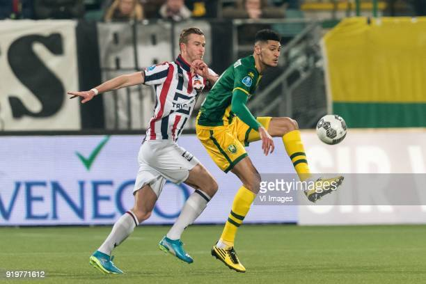 Thomas Meissner of Willem II Bjorn Johnsen of ADO Den Haag during the Dutch Eredivisie match between ADO Den Haag and Willem II Tilburg at Cars Jeans...