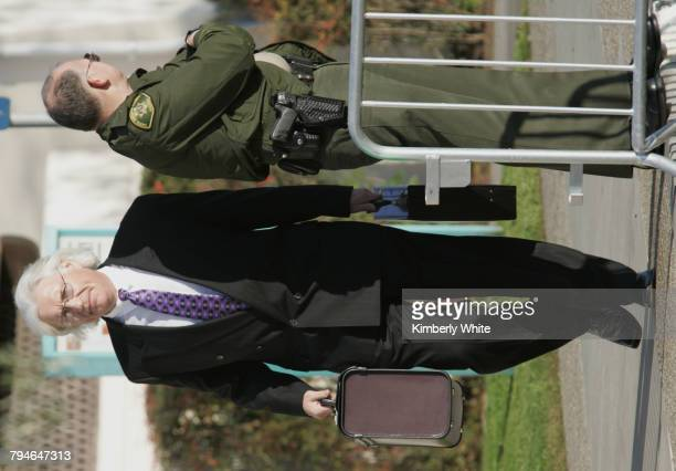 Thomas Mesereau Jr lead attorney for pop singer Michael Jackson walks past a sheriff on his way to the Santa Barbara County Courthouse Superior Court...