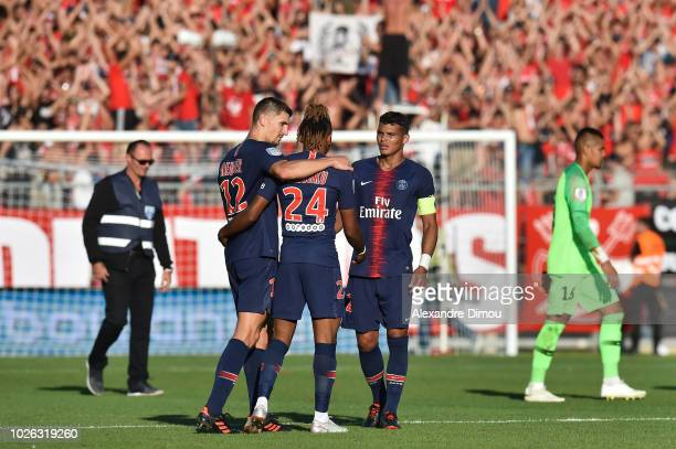 Thomas Meunier and Christopher Nkunku and Thiago Silva of Paris celebrates the Victory during the Ligue 1 match between Nimes and Paris Saint Germain...