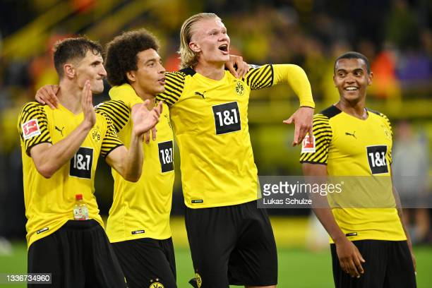 Thomas Meunier, Axel Witsel, Erling Haaland and Manuel Akanji of Borussia Dortmund celebrate their side's victory after the Bundesliga match between...