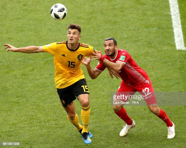 Thomas Meunier of Belgium battles for possession with Ali Maaloul of Tunisia during the 2018 FIFA World Cup Russia group G match between Belgium and...