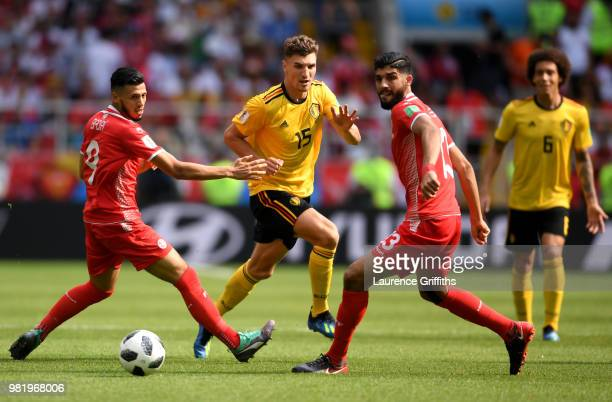 Thomas Meunier of Belgium challenge for the ball with Ferjani Sassi and Anice Badri of Tunisia during the 2018 FIFA World Cup Russia group G match...
