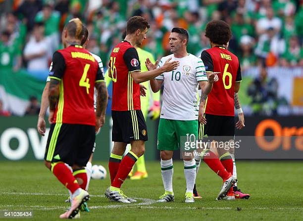 Thomas Meunier of Belgium in conversation with Robbie Keane of Republic of Ireland during the UEFA EURO 2016 Group E match between Belgium and...