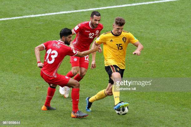 Thomas Meunier of Belgium is challenged by Ferjani Sassi and Ali Maaloul of Tunisia during the 2018 FIFA World Cup Russia group G match between...