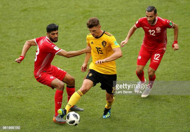 Thomas Meunier of Belgium is challenged by Ferjani Sassi of Tunisia and Ali Maaloul of Tunisia during the 2018 FIFA World Cup Russia group G match...