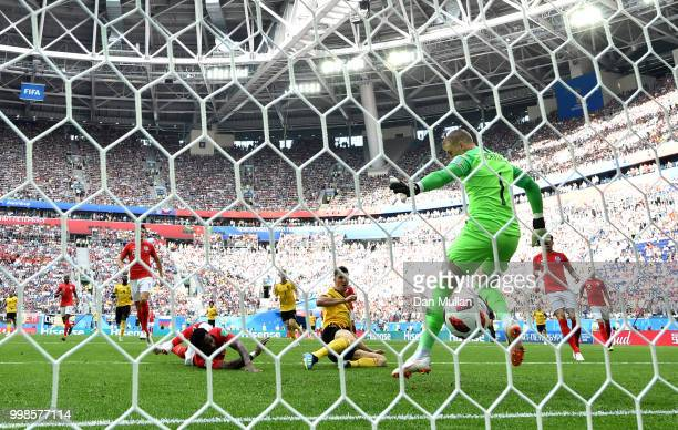 Thomas Meunier of Belgium scores his team's first goal past Jordan Pickford of England during the 2018 FIFA World Cup Russia 3rd Place Playoff match...
