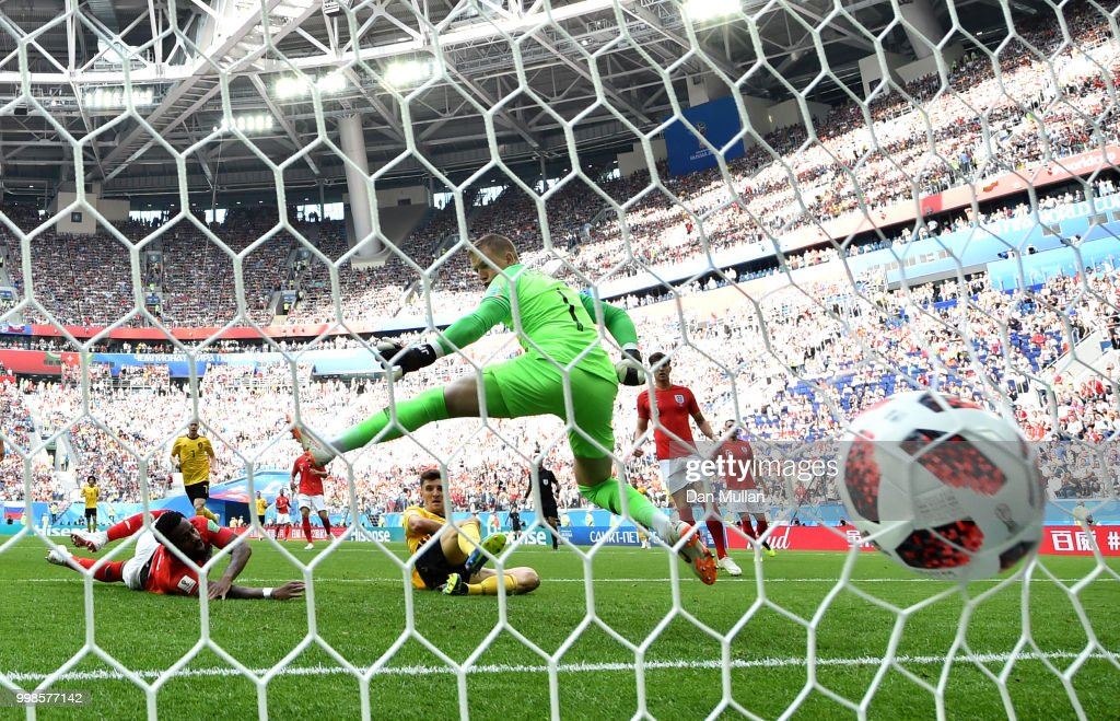 Thomas Meunier of Belgium scores his team's first goal past Jordan Pickford of England during the 2018 FIFA World Cup Russia 3rd Place Playoff match between Belgium and England at Saint Petersburg Stadium on July 14, 2018 in Saint Petersburg, Russia.