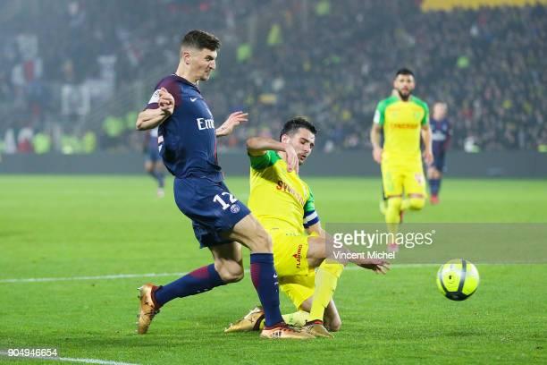 Thomas Meunier of Paris Saint Germain and Leo Dubois of Nantes during the Ligue 1 match between FC Nantes and Paris Saint Germain at Stade de la...