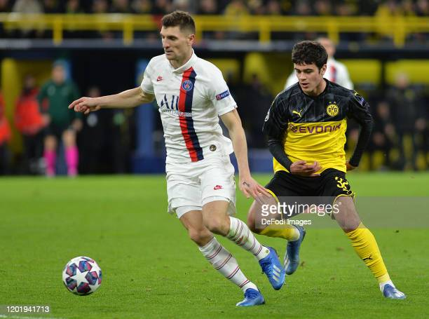 Thomas Meunier of Paris Saint-Germain and Giovanni Reyna of Borussia Dortmund battle for the ball during the UEFA Champions League round of 16 first...