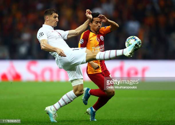 Thomas Meunier of Paris SaintGermain battles for possession with Yuto Nagatomo of Galatasaray during the UEFA Champions League group A match between...