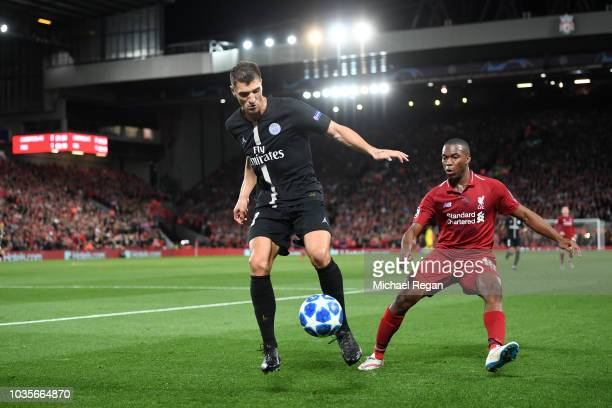Thomas Meunier of Paris SaintGermain controls the ball under pressure from Daniel Sturridge of Liverpool during the Group C match of the UEFA...