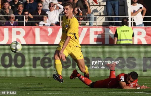 Thomas Meunier of Paris SaintGermain in action during the Ligue 1 match between Dijon FCO and Paris Saint Germain at Stade GastonGerard on October 14...