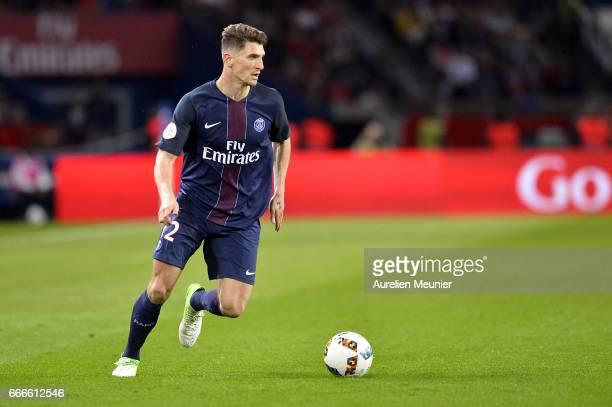 Thomas Meunier of Paris SaintGermain runs with ball scoring during the Ligue 1 match between EA Guingamp and Paris SaintGermain at Parc des Princes...