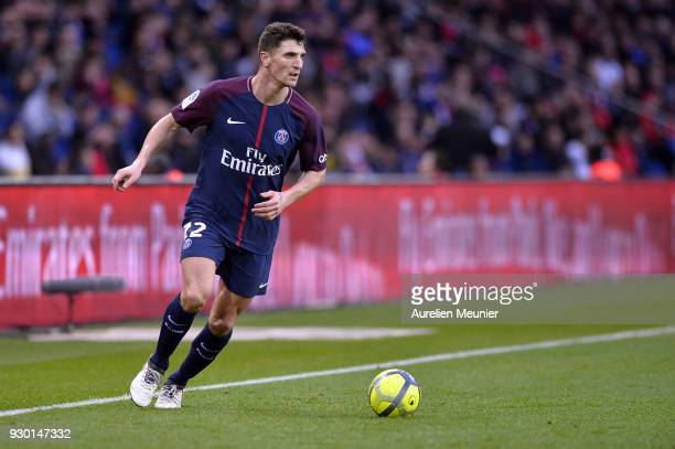 Thomas Meunier of Paris SaintGermain runs with the ball during the Ligue 1 match between Paris Saint Germain and Metz at Parc des Princes on March 10...