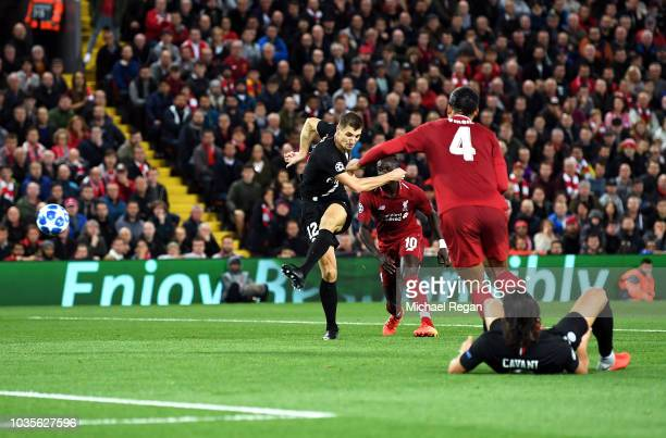 Thomas Meunier of Paris Saint-Germain scores his team's first goal during the Group C match of the UEFA Champions League between Liverpool and Paris...