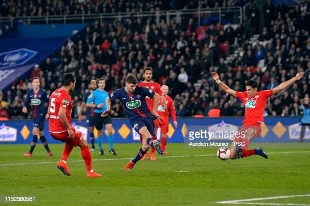 Thomas Meunier of Paris Saint-Germain shoots on goal during the French League Cup match between Paris Saint-Germain and Dijon at Parc des Princes on...