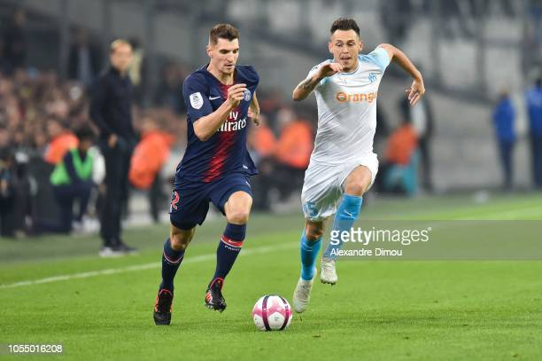 Thomas Meunier of PSG and Lucas Ocampos of Marseille during the Ligue 1 match between Olympique Marseille and Paris Saint Germain on October 28 2018...
