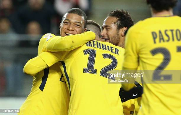 Thomas Meunier of PSG celebrates his goal between Kylian Mbappe and Neymar Jr of PSG during the French League Cup match between Stade Rennais and...