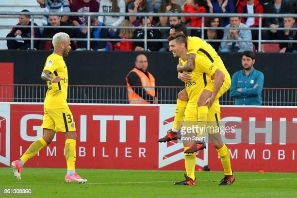 Thomas Meunier of PSG celebrates scoring during the Ligue 1 match between Dijon FCO and Paris Saint Germain at Stade Gaston Gerard on October 14 2017...