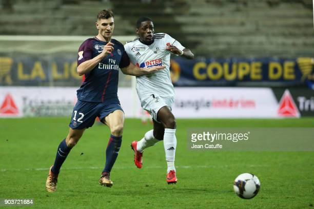 Thomas Meunier of PSG Harrison Manzala of Amiens during the French League Cup match between Amiens SC and Paris Saint Germain at Stade de la Licorne...