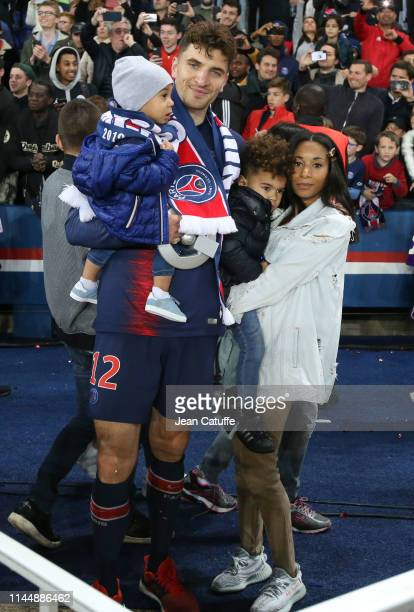 Thomas Meunier of PSG with his partner Deborah Panzokou and their sons celebrate winning the 'French Championship 20182019' during the trophy...