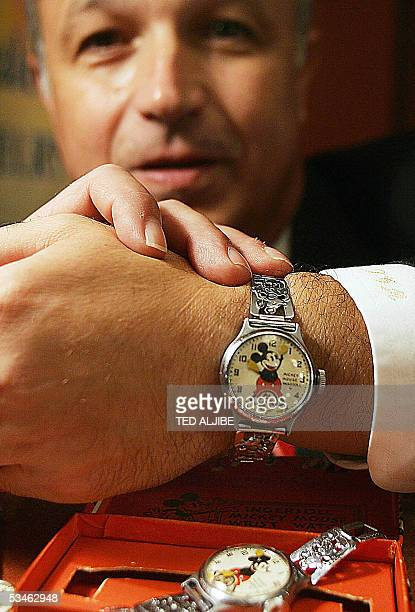 Thomas Milani of the US shows a Mickey Mousedesigned watch for sale at the Antique and Modern Watch Jewelry Show at a hotel in Hong Kong 26 August...