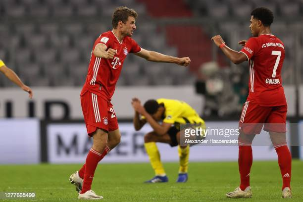 Thomas Müller of FC Bayern Muenchen celebrates victory with his team mate Serge Gnabry after winning the Supercup 2020 match between FC Bayern...