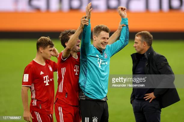 Thomas Müller of FC Bayern Muenchen celebrates victory with his team mate Alexander Nübel after winning the Supercup 2020 match between FC Bayern...