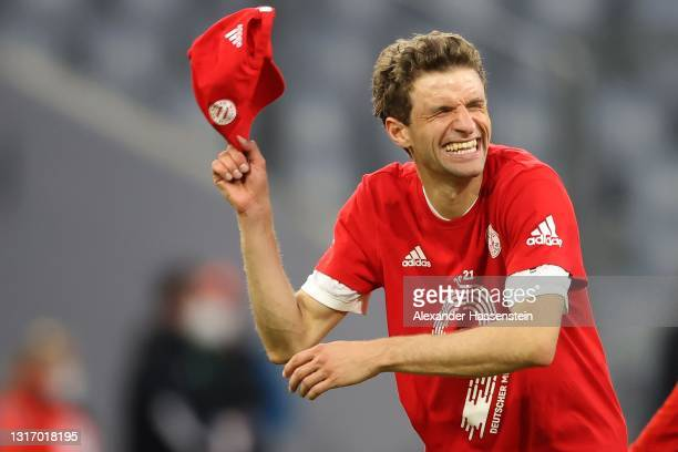 Thomas Müller of FC Bayern Muenchen celebrates winning the Bundesliga title after the Bundesliga match between FC Bayern Muenchen and Borussia...