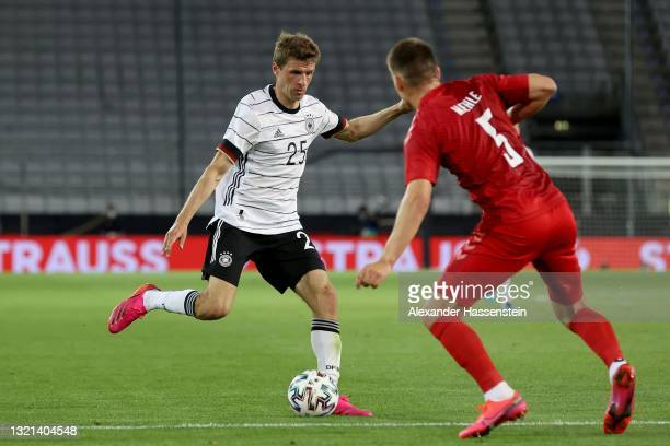 Thomas Müller of Germany battles for possession with Joakim Maehle of Denmark during the international friendly match between Germany and Denmark at...