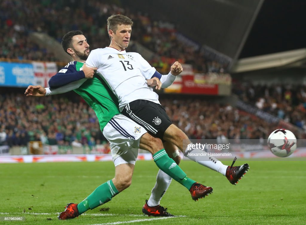 Thomas Mller of Germany is challenged by Conor McLaughlin of Northern Ireland during the FIFA 2018 World Cup Qualifier between Northern Ireland and Germany at Windsor Park on October 5, 2017 in Belfast, Northern Ireland.
