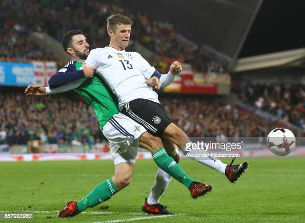 Thomas Mller of Germany is challenged by Conor McLaughlin of Northern Ireland during the FIFA 2018 World Cup Qualifier between Northern Ireland and...