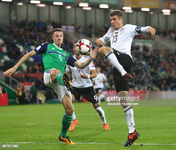Thomas Mller of Germany is challenged by Jonny Evans of Northern Ireland during the FIFA 2018 World Cup Qualifier between Northern Ireland and...