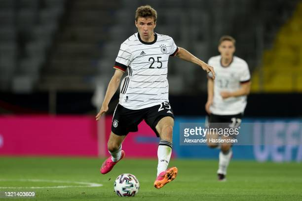 Thomas Müller of Germany runs with the ball during the international friendly match between Germany and Denmark at Tivoli Stadion on June 02, 2021 in...