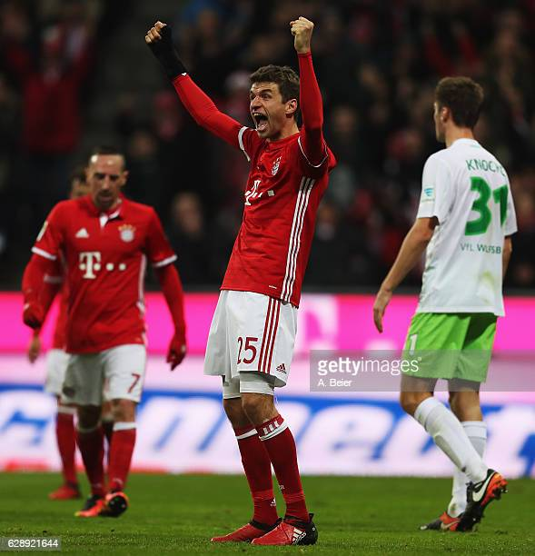 Thomas Müller of Muenchen celebrates scoring the fourth goal during the Bundesliga match between Bayern Muenchen and VfL Wolfsburg at Allianz Arena...