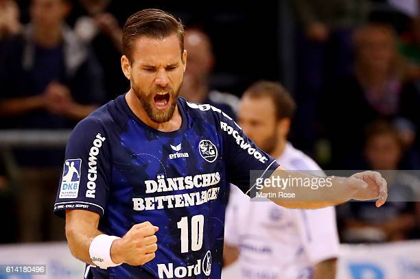 Thomas Mogensen of Flensburg celebrates during the DKB HBL Bundesliga match between SG FlensburgHandewitt and VfL Gummersbach at FlensArena on...