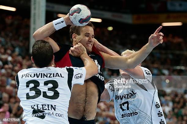 Thomas Mogensen of Flensburg challenges for the ball with Dominik Klein of Kiel during the DKB HBL Bundesliga match between THW Kiel and SG...