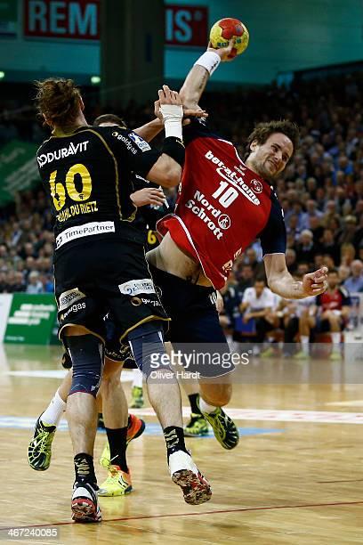 Thomas Mogensen of Flensburg challenges for the ball with Kim Ekdahl Du Rietz of Rhein Neckar during the Bundesliga handball match between Flensburg...