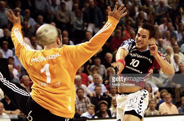 Thomas Mogensen of Flensburg competes with keeper Thierry Omeyer of Kiel during the Budesliga match between SG FlensburgHandewitt and THW Kiel at the...