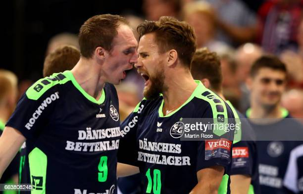 Thomas Mogensen of Flensburg Handewitt celebrate with team mate Holger Glandorf after the Velux EHF Champions League round of 16 second leg match...
