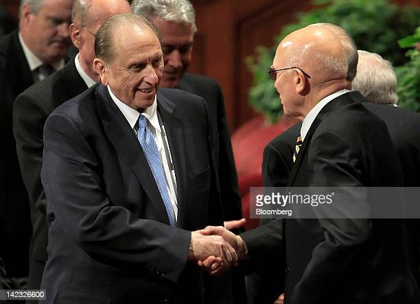 Thomas Monson, president of the Church of Jesus Christ of Latter-day Saints, left, shakes hands with Mormon Apostle Dallin Oaks during the 182nd...
