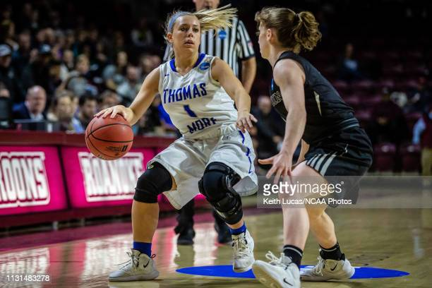Thomas More Saints guard Michaela Ware puts on the brakes s Bowdoin Bears guard Samantha Roy cuts her off during the Division III Women's Basketball...
