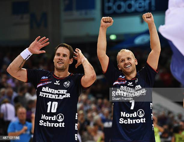 Thomas Morgensen and Anders Eggert of Flensburg celebrate during the DKB Handball Bundeslga match between SG FlensburgHandewitt and THW Kiel at...