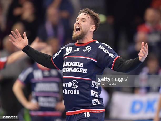 Thomas Morgensen of Flensburg celebrates during the DKB Bundesliga Handball match between SG FlensburgHandewitt and Fuechse Berlin at FlensArena on...