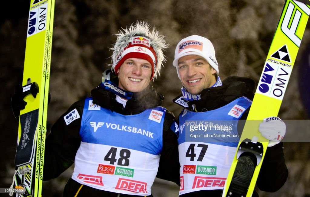 Thomas Morgenstern and Andreas Kofler of Austria (L-R) celebrate after the individual HS142 competition during the FIS Ski Jumping World Cup on November 28, 2010, in Kuusamo, Finland.